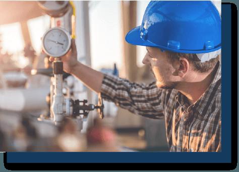 construction worker checking pressure gauges