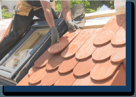 worker repairing a roof